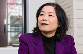 Director of AIMR, Motoko Kotani, likens the international cooperation between researchers as being like musicians playing together in an ensemble.