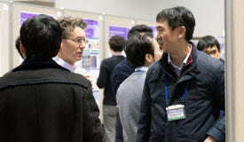 Researchers interacting at the symposium's poster session.